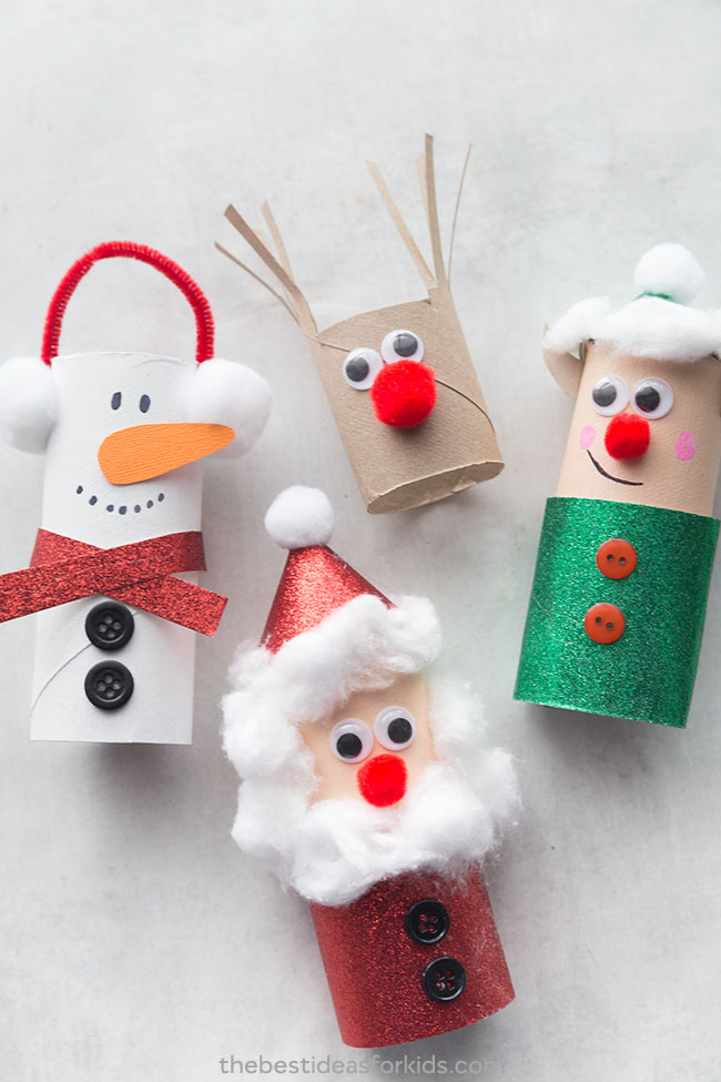 An image of Christmas crafts. Four christmas themed characters made from toilet paper roll and cardboard. The image contains a reindeer, snowman, Santa and Mrs Claus