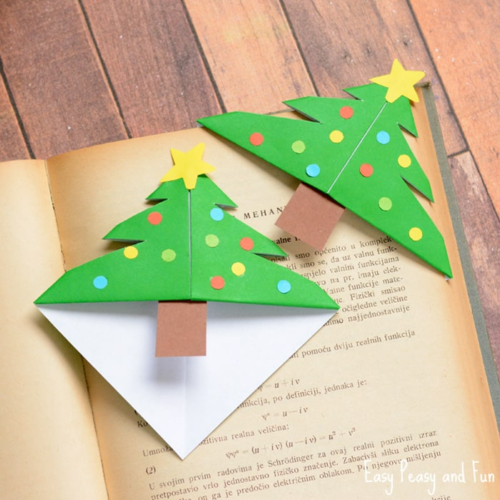 An image of two Christmas Tree bookmarks on an old book.