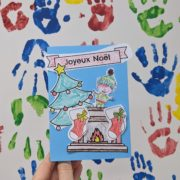 A picture of a handmade Christmas card with the words 'Joyeux Noel'