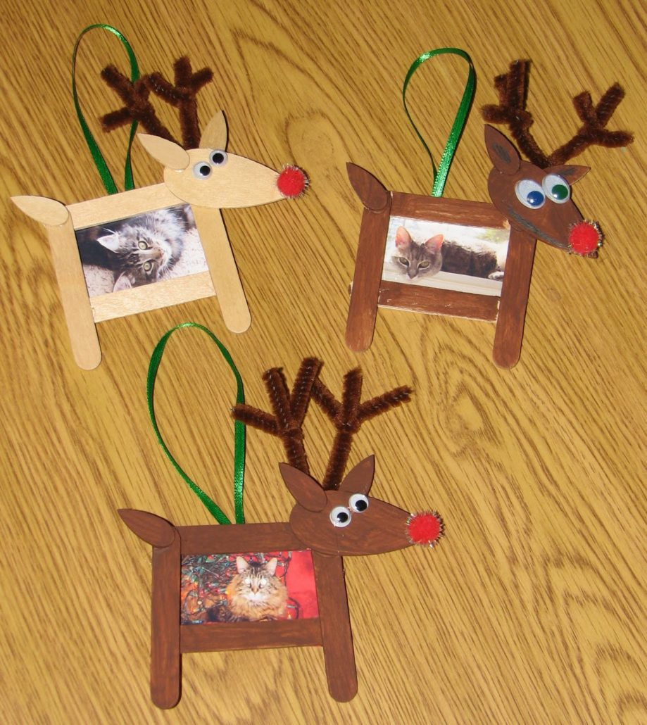 Christmas crafts. An image of paddlepop sticks arranged to make a picture frame, decorated like reindeer.