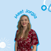 Jorgia Smiling on Blue Background